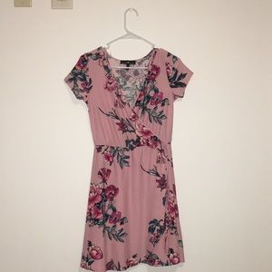 A pink floral dress with a long V-neck.